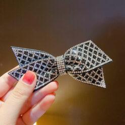 黑色蝴蝶結水鑽格子交叉髮夾