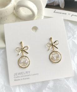 [925銀針]甜美珍珠蝴蝶結耳環